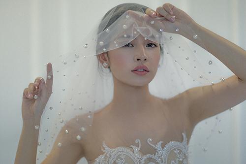 Chi pu làm cô dâu thiên thần với váy cưới ren trắng - 1