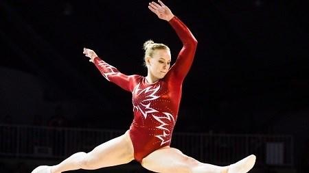 Lý do vận động viên thể dục dụng cụ mang tất khi tham gia olympic - 1