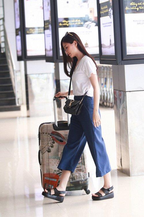 Thời trang sân bay điệu đà của hoa hậu á hậu việt - 9