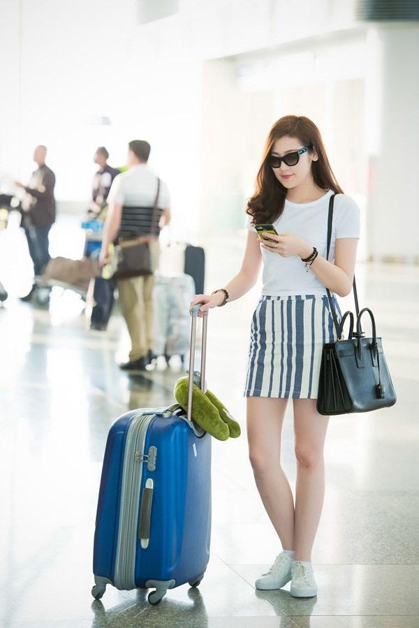 Thời trang sân bay điệu đà của hoa hậu á hậu việt - 10