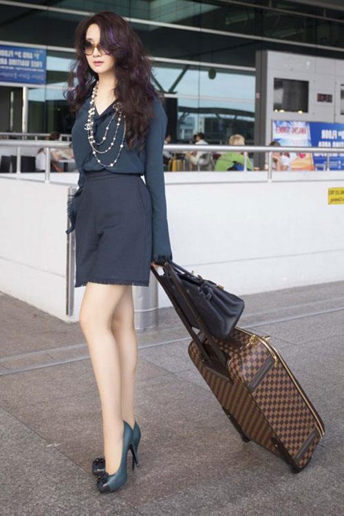 Thời trang sân bay điệu đà của hoa hậu á hậu việt - 12