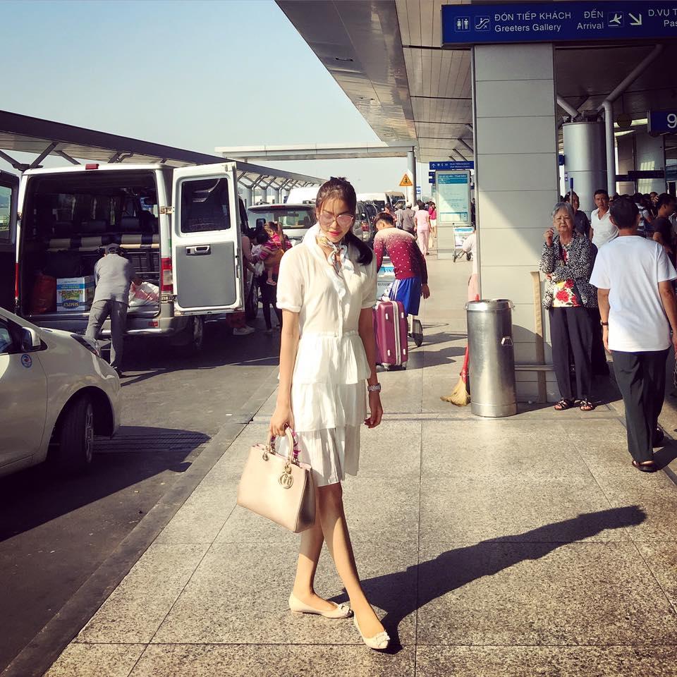 Thời trang sân bay điệu đà của hoa hậu á hậu việt - 1